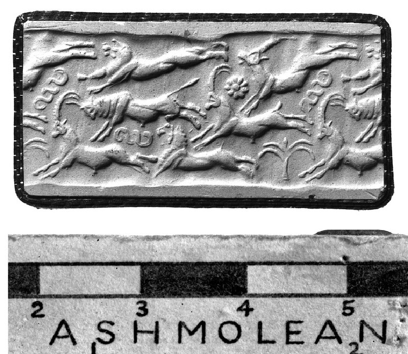 Old Syrian cylinder seal, lion and antelope above bull and ibex over ibex and lion