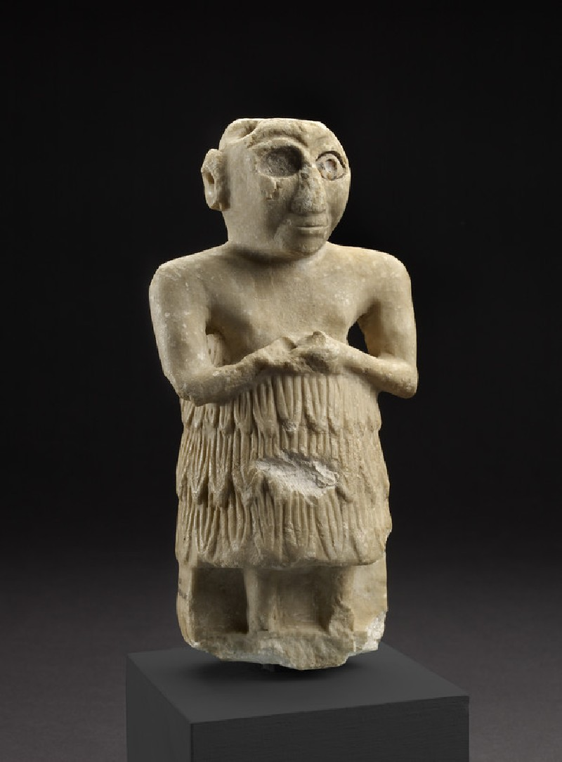 Sumerian statue of a male worshipper originally placed in a temple as a dedication to the gods