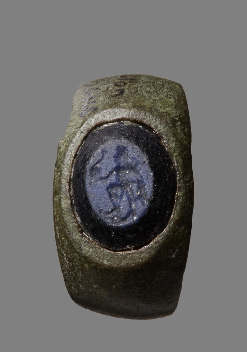 Bronze finger ring set with engraved intaglio: Neptune with dolphin and trident