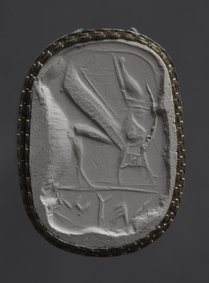 Scaraboid stamp seal depicting a winged griffin in apron with falcon head wearing Egyptian double crown
