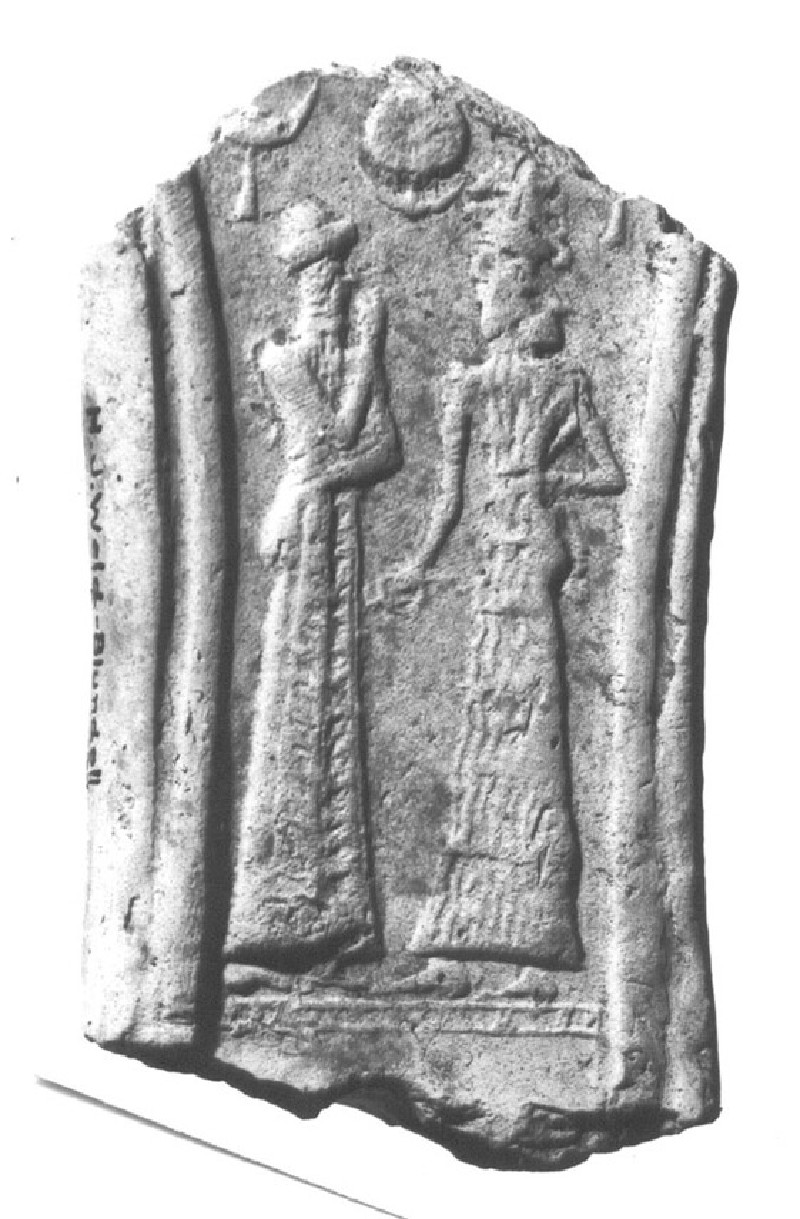 Fragment from the centre of a model chariot front with female figure and sun disc (AN1922.177)