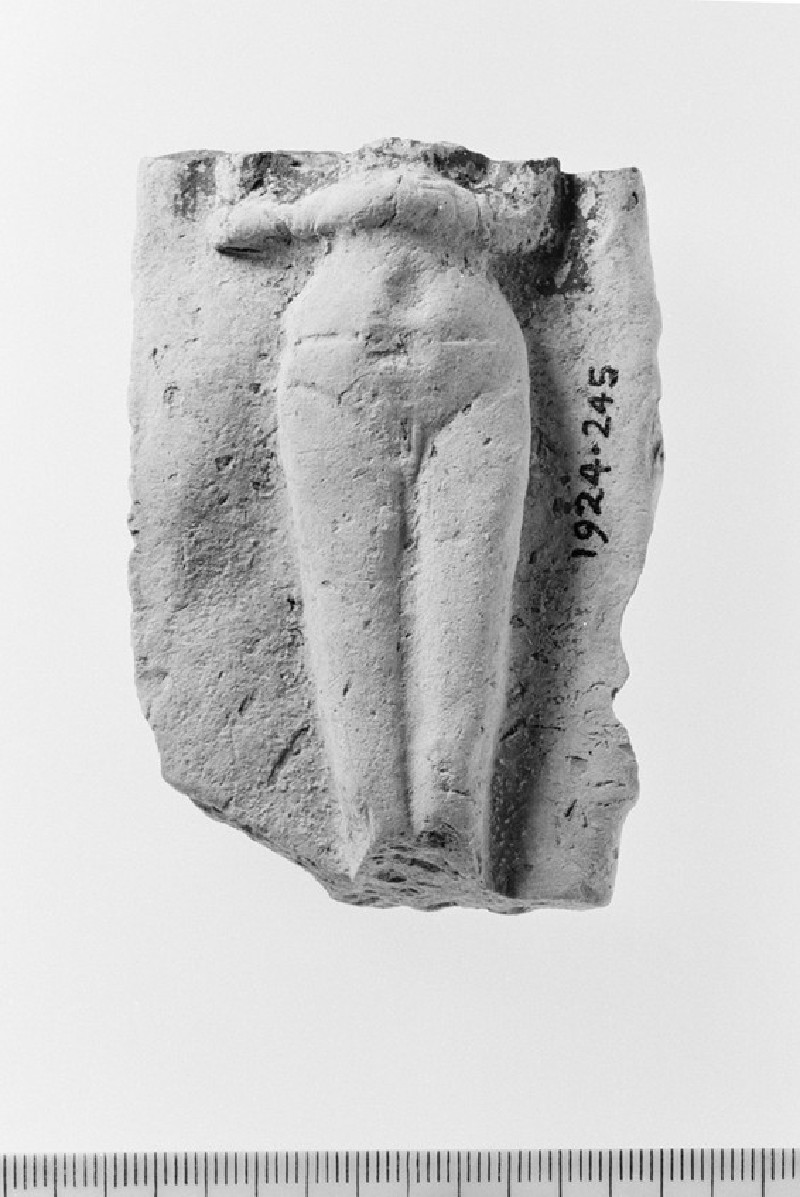 Nude female figurine clasping her hands on her abdomen