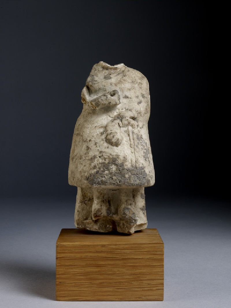 Statuette fragment of a seated woman wearing a bell-shaped skirt