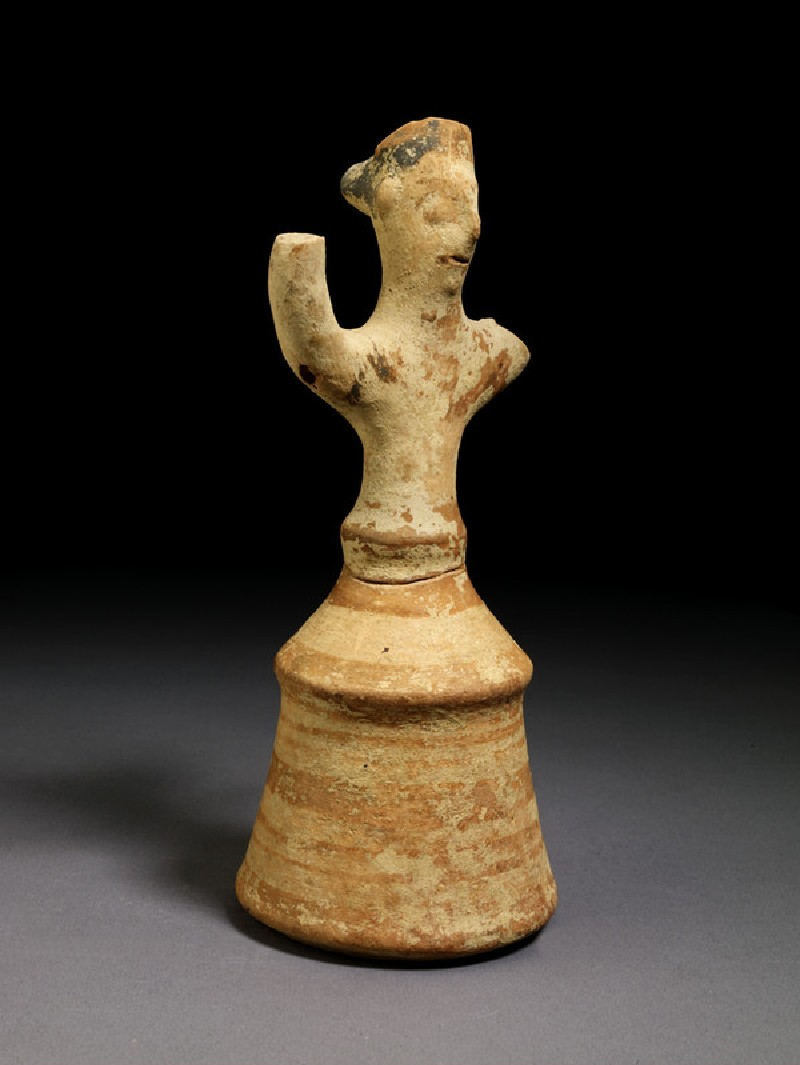 Terracotta figurine of female in bell skirt with raised arms