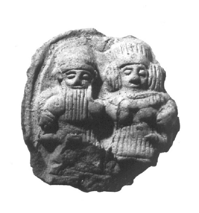 Plaque of embracing couple (AN1924.671)