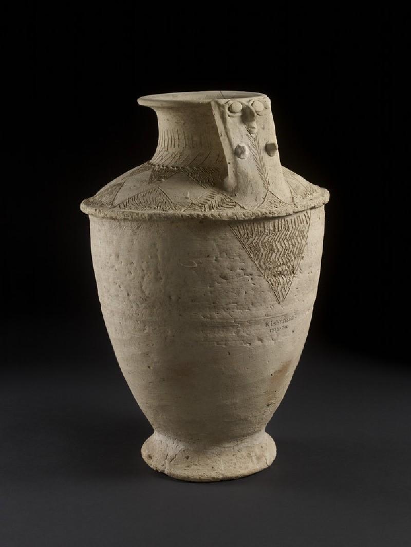 Upright-handled jar with mother goddess design