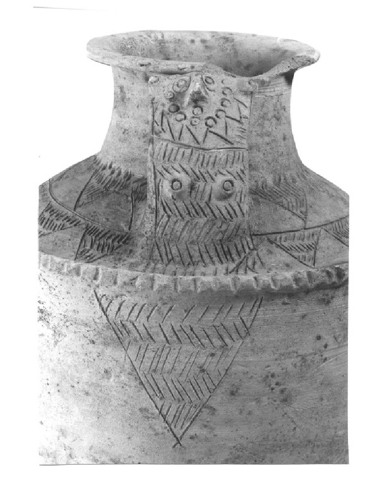 Upright-handled jar with mother goddess design