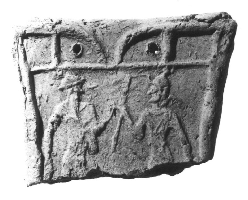 Fragment of the upper front of a chariot model, the god Martu facing the goddess Ishtar (AN1926.481)