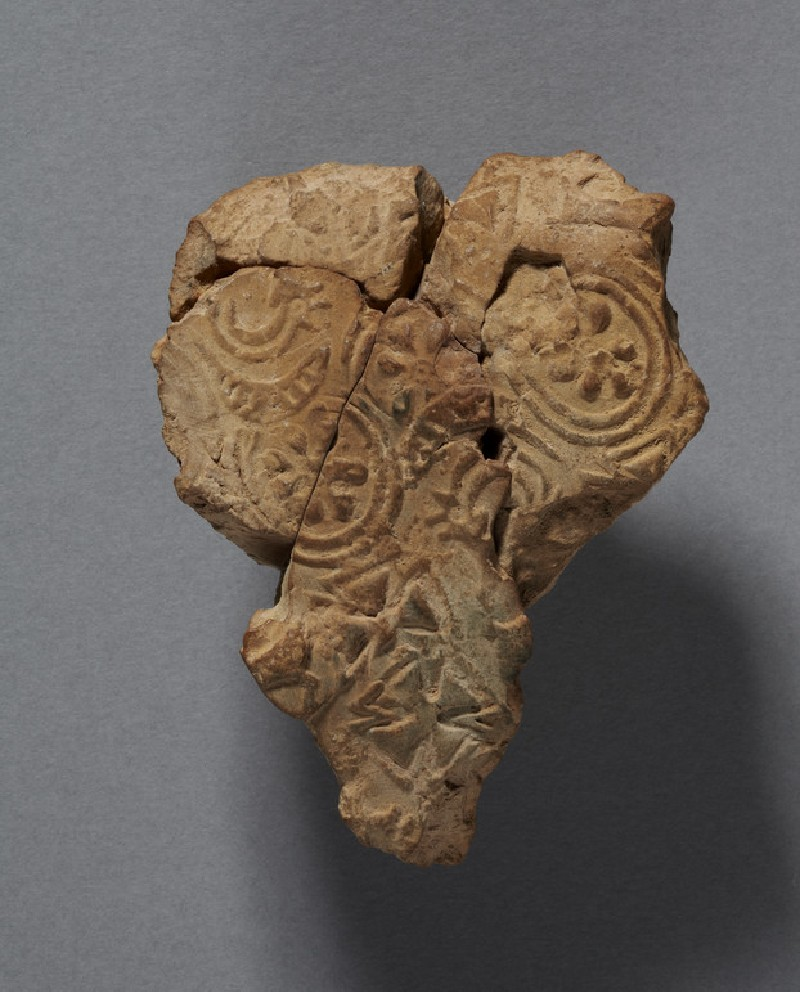Bulla with rosettes, crosses, and an ibex under a frond