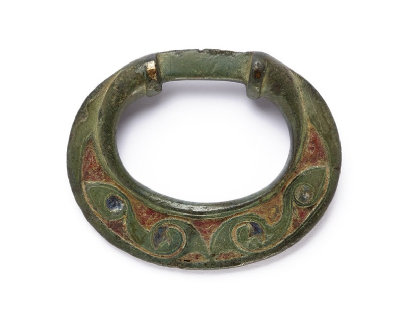 Bronze terret with blue and red enamelled decoration