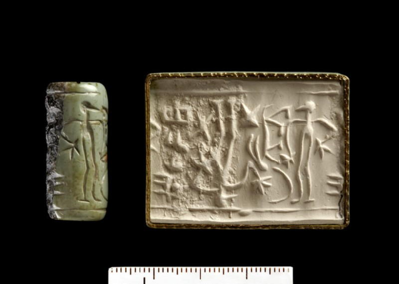 Cylinder seal with ingot depiction and vertical Cypro-Minoan inscription of 4 signs (AN1933.1096)