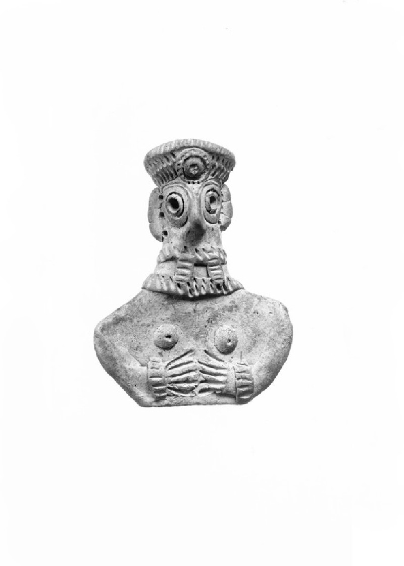 Female figurine with crown and long hair