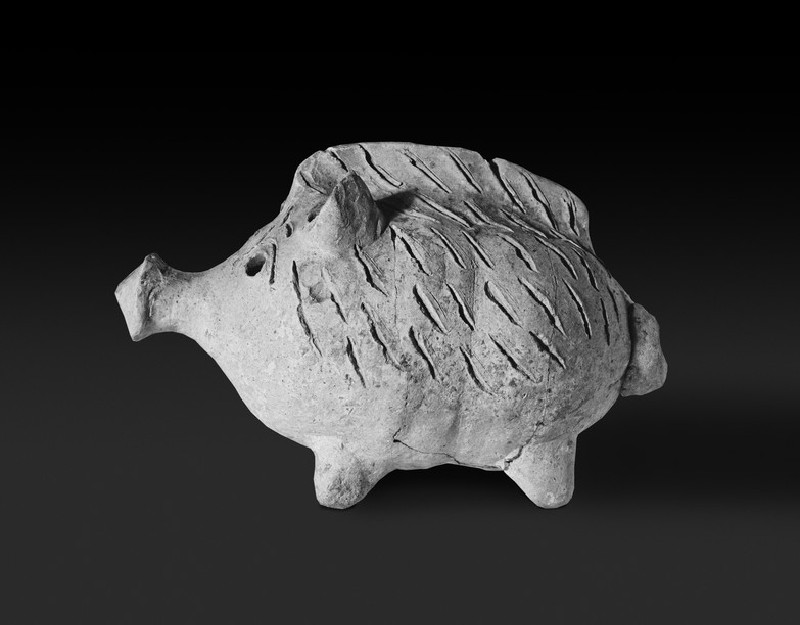 Boar-shaped vase, terracotta figure