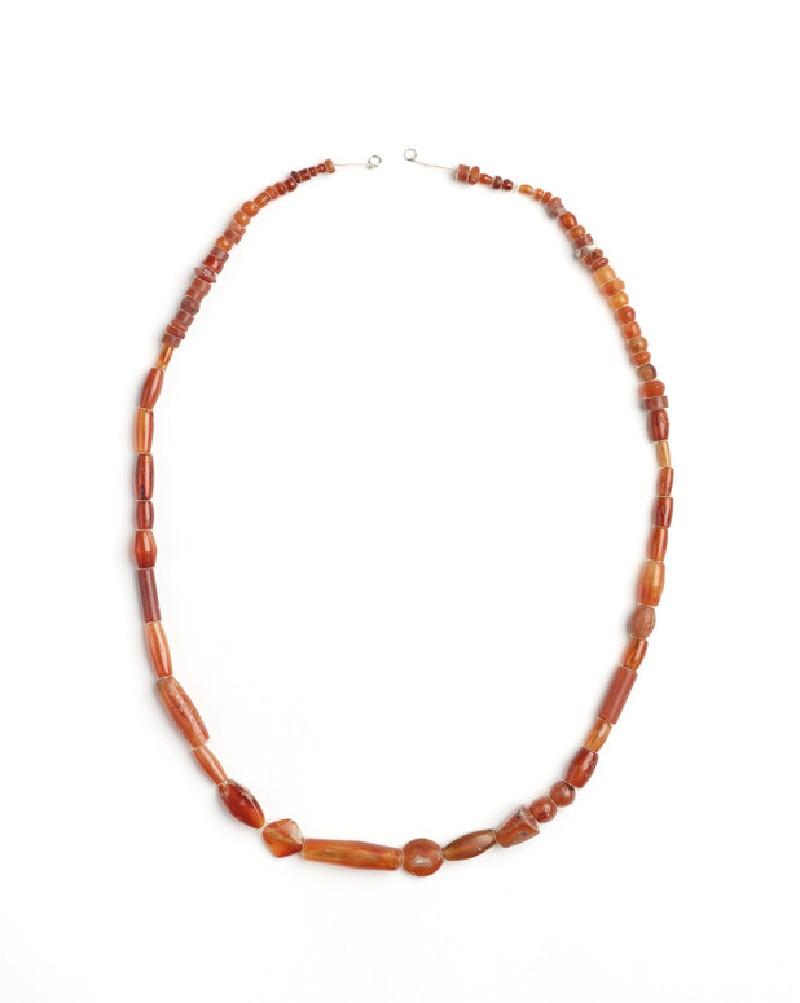 Strung carnelian beads