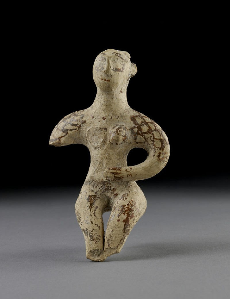 Terracotta figurine of a seated male