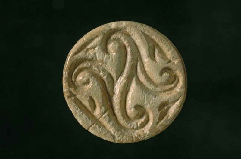 Conoid hippo ivory seal. Decorated with quatrefoil design