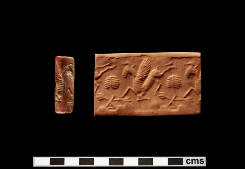 Cylinder seal depicting galloping winged goat and bush