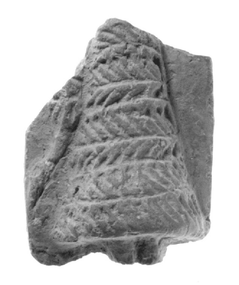 Plaque with part of a female figure in relief