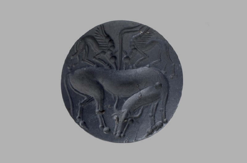 Lentoid seal showing a bull attacking two griffins