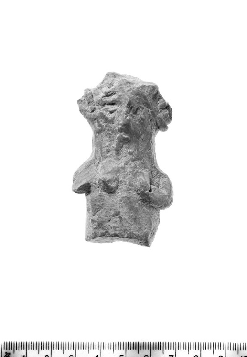 Upper section of female figurine (AN1939.614)