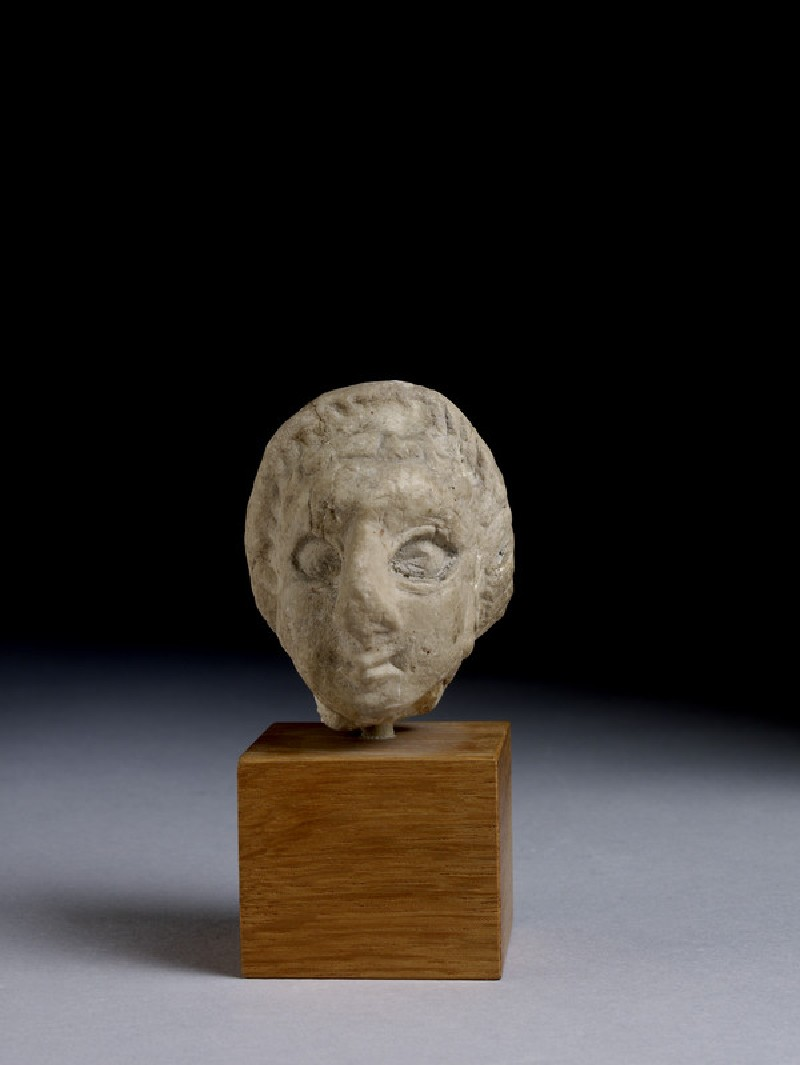 Figurine, fragment of female head (AN1946.265)