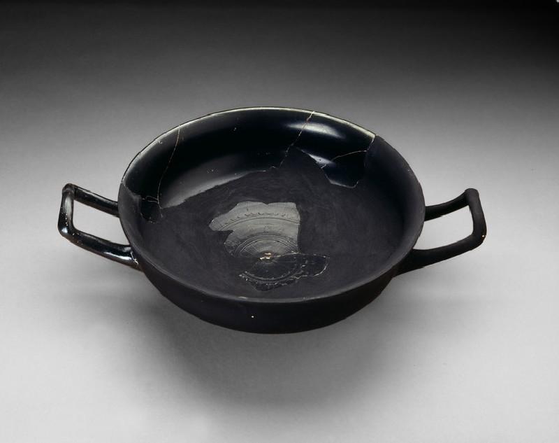 Attic black-glaze stemless cup (AN1948.105)