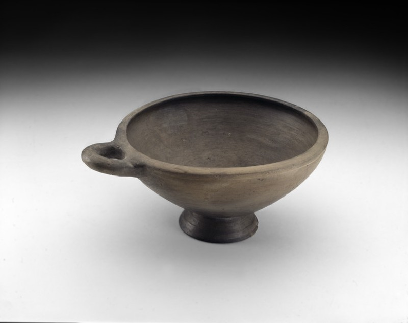 One-handled burnished grey-ware cup with concial foot