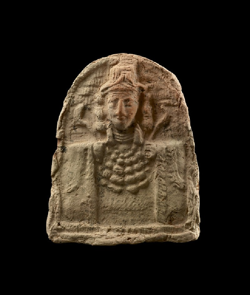 Semi-circular plaque of female bust, the goddess Ishtar (AN1949.920)