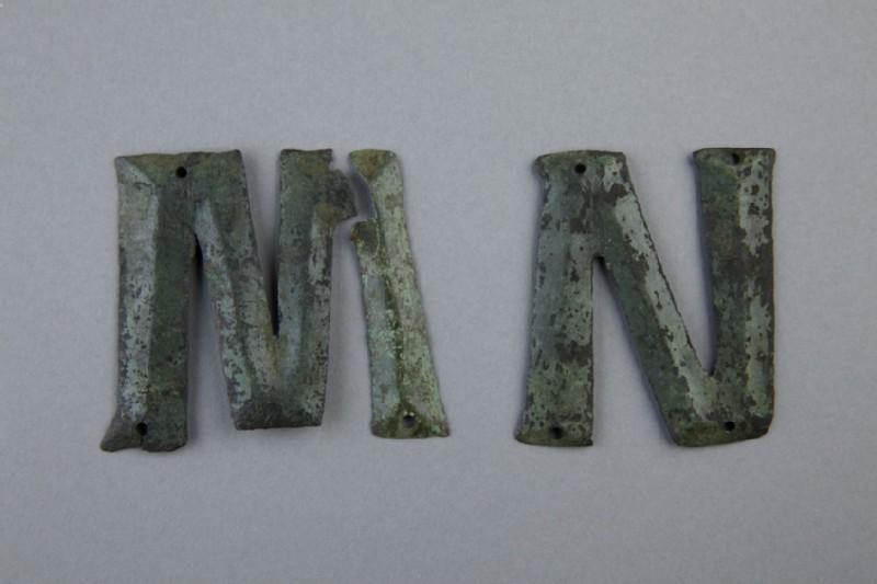 Bronze letter M