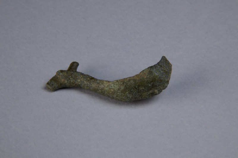 Bronze fibula in the shape of a dolphin (AN1952.571)