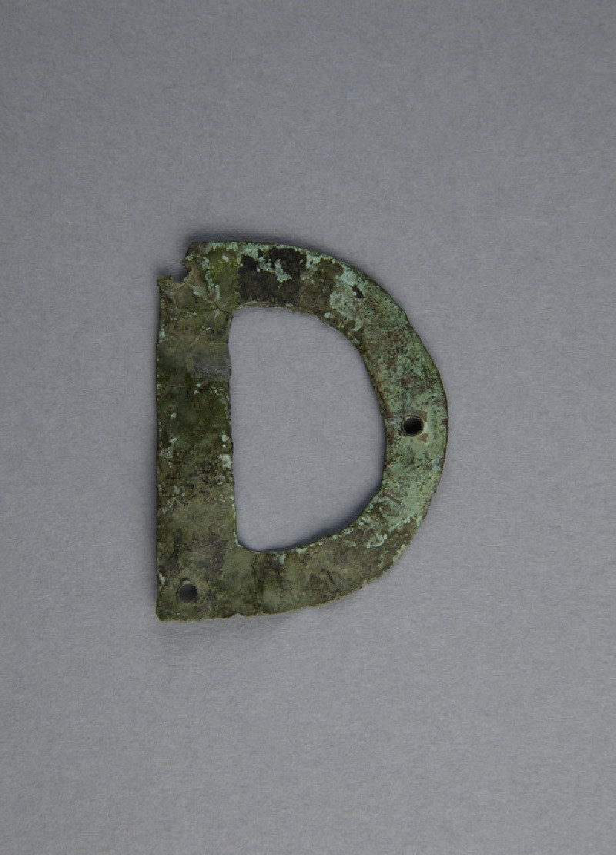 Bronze letter D