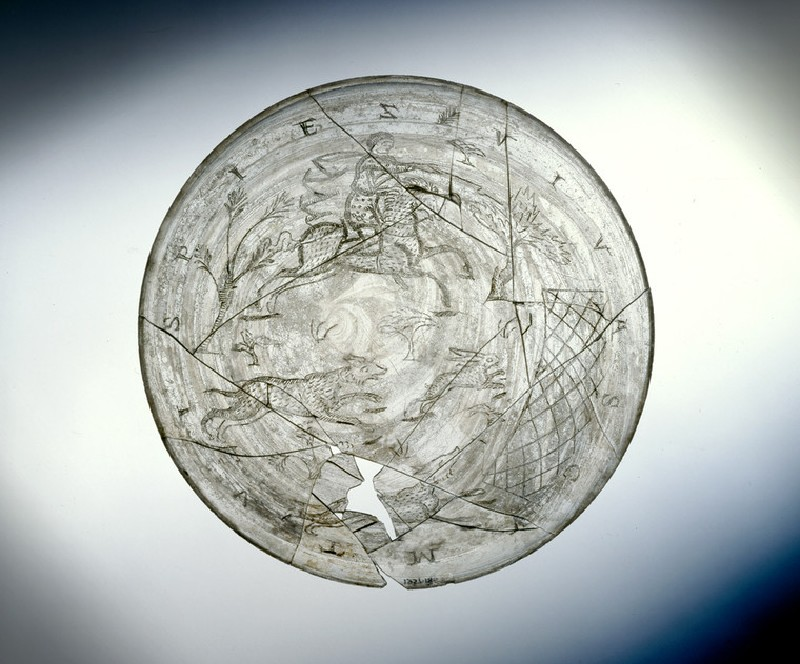 Engraved glass bowl (Wint Hill Bowl) with a huntsman and two hounds driving a hare into a net, inscribed 'Drink, live with your (folk)' (AN1957.186)