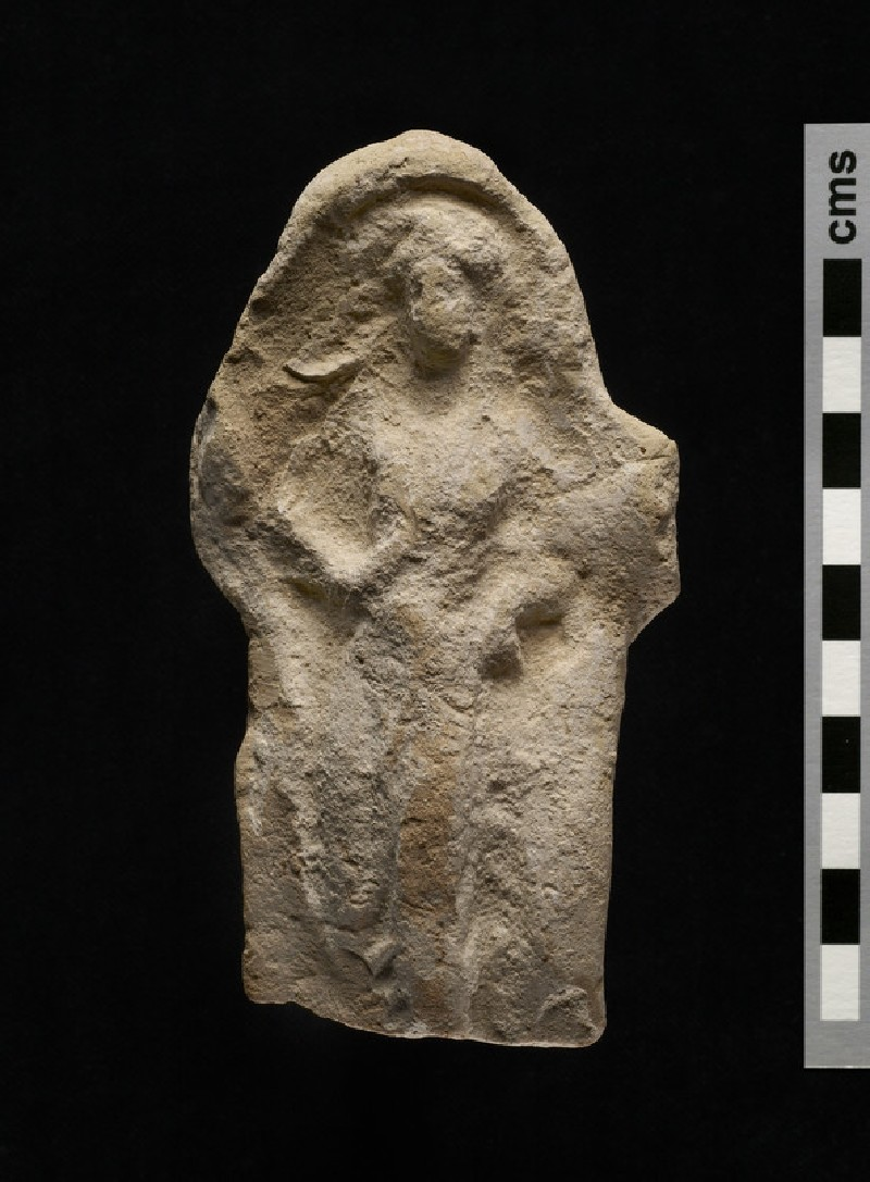 Terracotta relief plaque of draped female figure, bordered by bead moulding frame (AN1960.649)