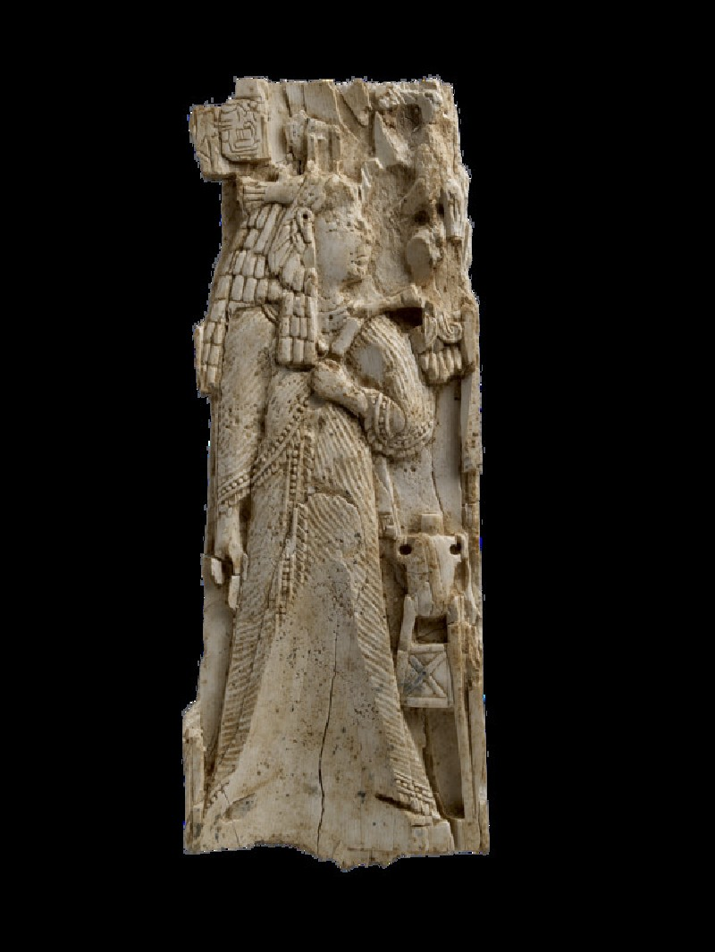 Ivory plaque carved with woman or goddess wearing vulture-capped wig in Egyptian style, inscription