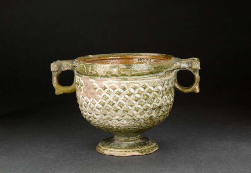 Green-and-yellow glazed two-handled kantharos cup