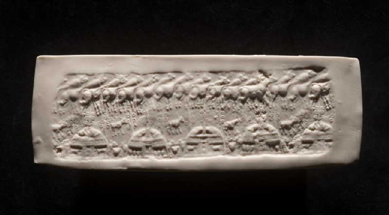 Impression from cylinder seal depicting four thatched huts and livestock (AN1964.744.b)