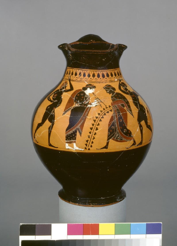 Attic black-figure pottery jug depicting a festive scene