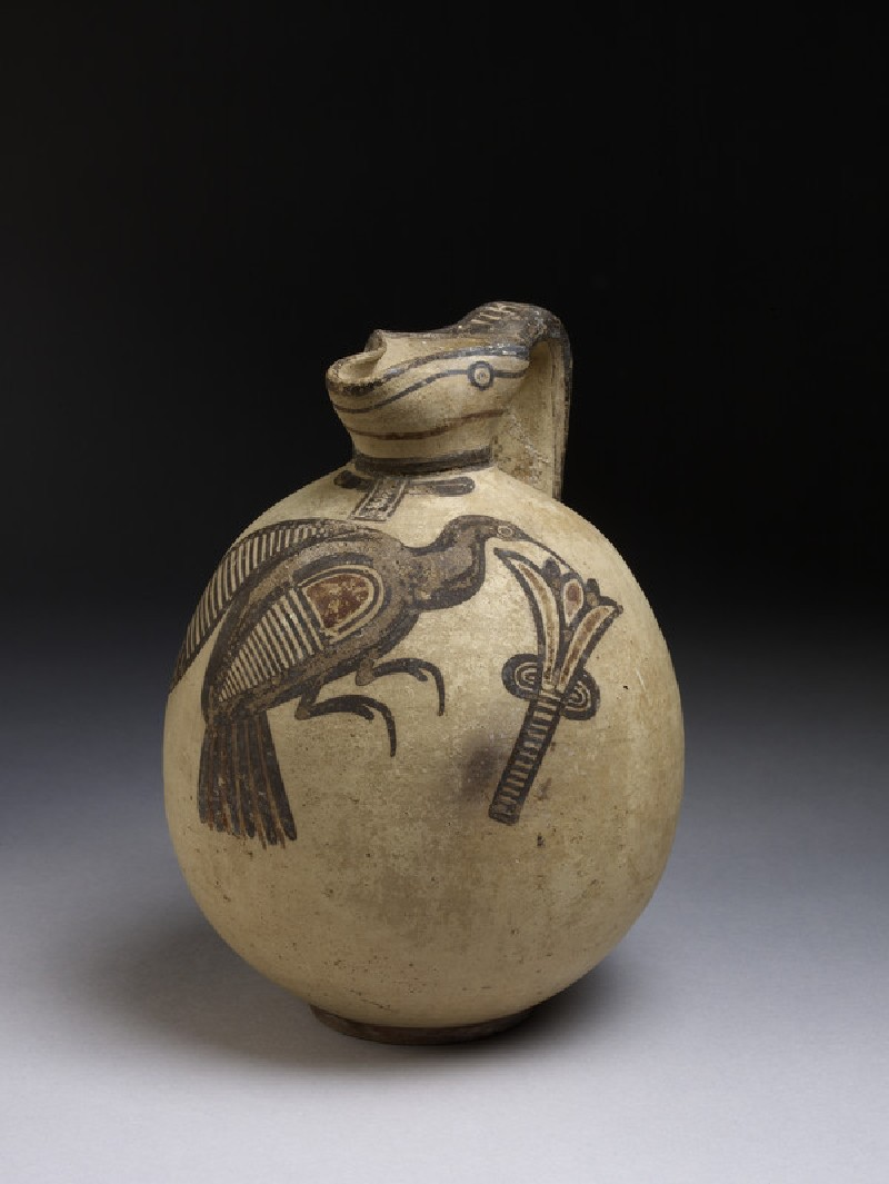 Squat bichrome jug in free-field style with image of bird picking a lotus flower (AN1967.1088)