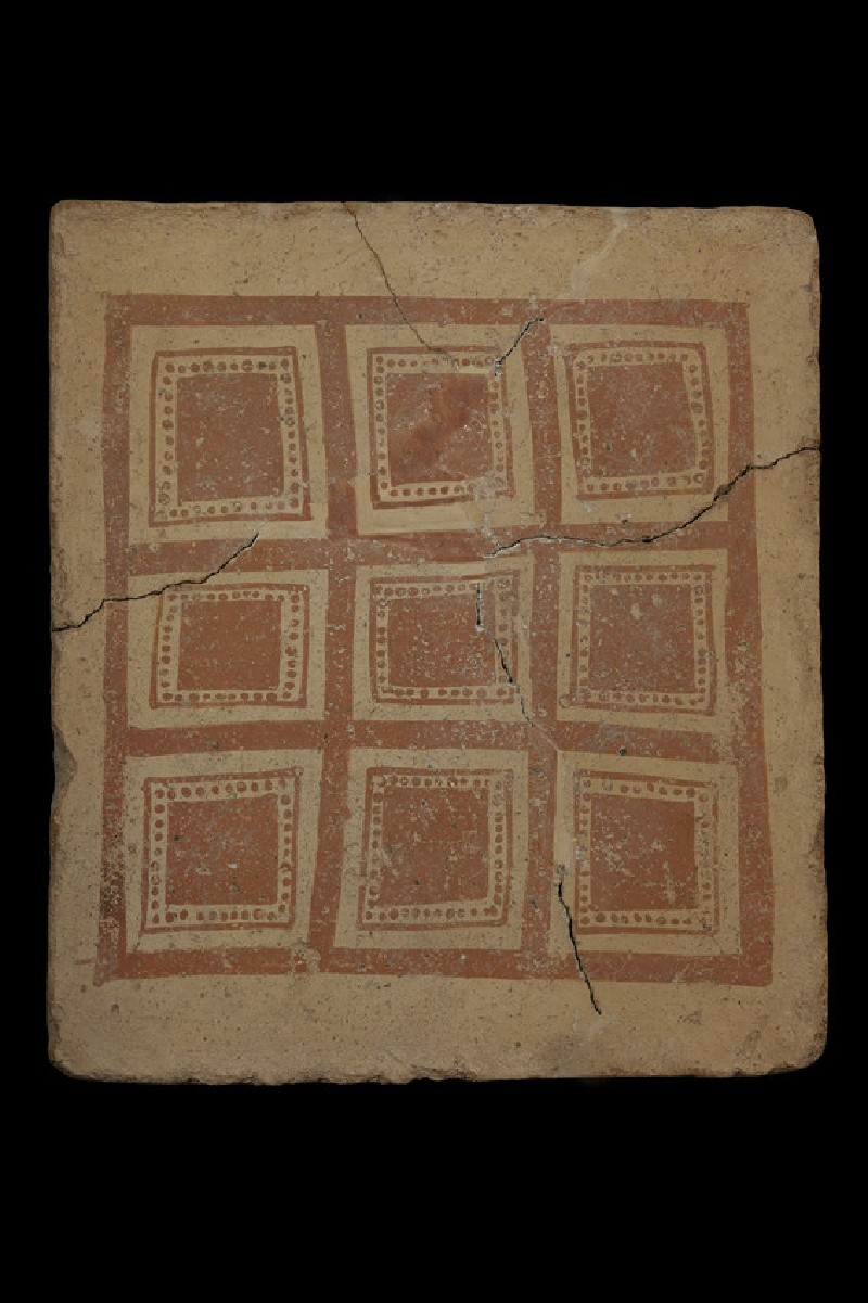 Terracotta tile with painted geometric design of square divided into nine regularly arranged smaller squares (AN1968.1529)