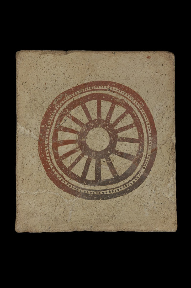 Painted terracotta tile with painted design of 14 spoked wheel (AN1969.34)