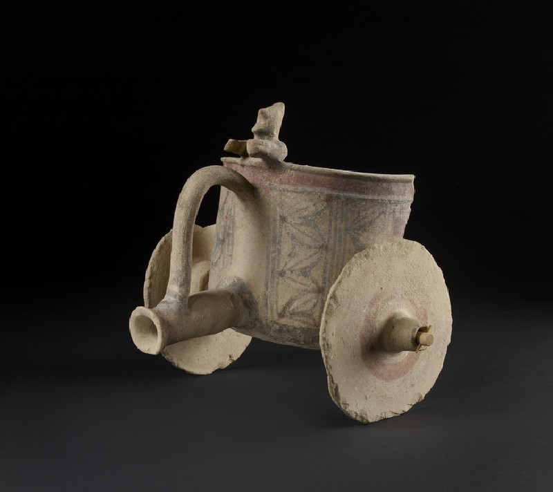Bichrome terracotta figurine of a model of a chariot with driver (AN1969.488)