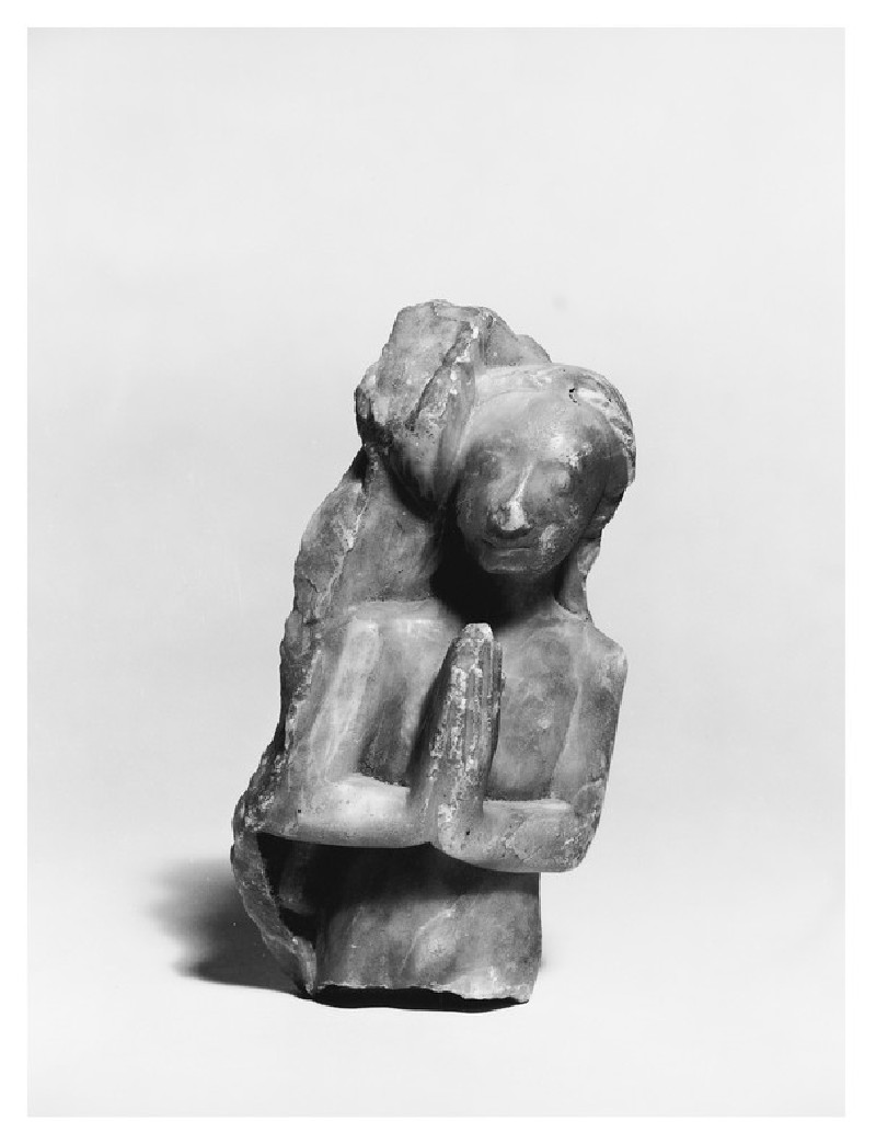 Alabaster table fragment in the form of a naked female (AN1970.594)
