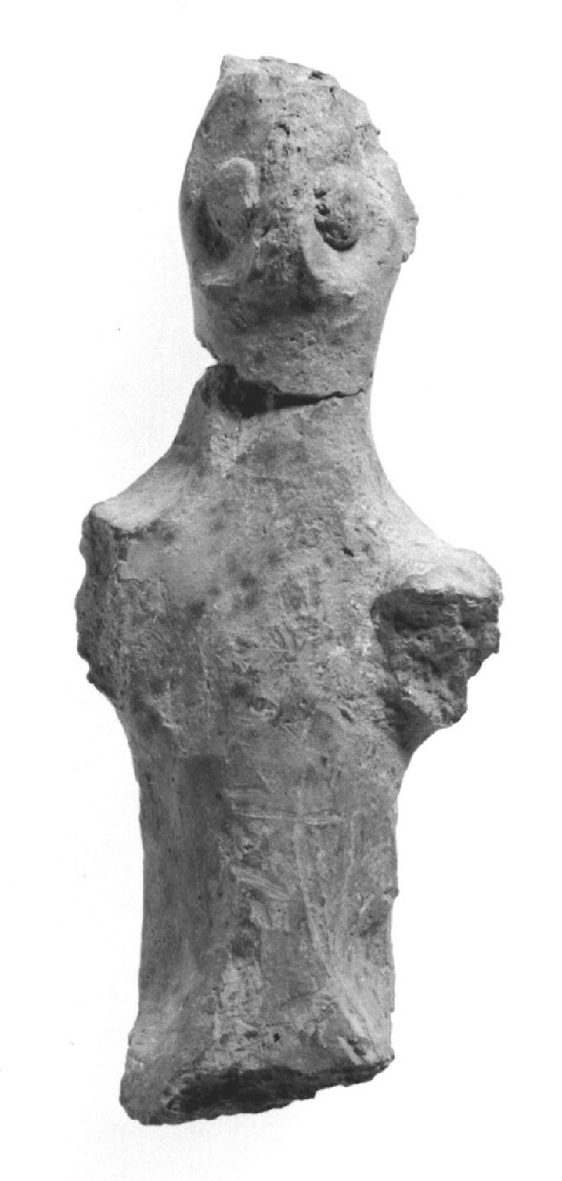 Fragmentary figurine, possibly of a man (AN1970.95)