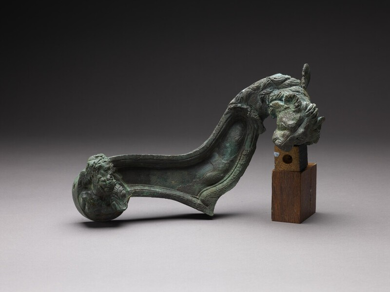Bronze fulcrum (ornamental couch-end) decorated with a lion and a head of the hero Hercules