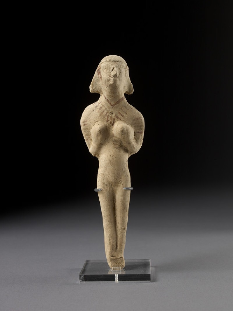Naked female, possibly a goddess, holding her breasts (Astarte figurine) (AN1971.854)