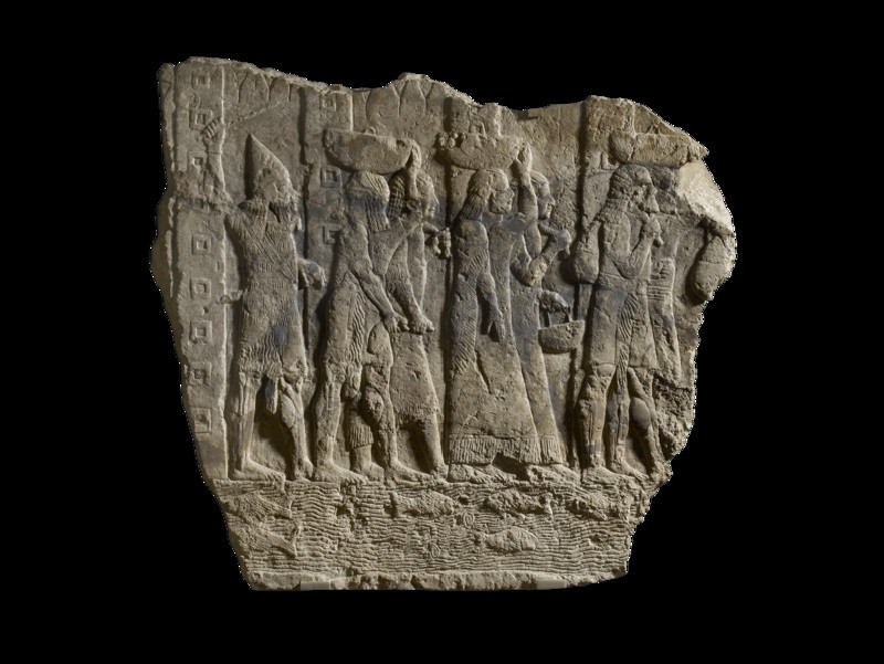 Relief, fragment depicting soldiers escorting loot and captives from Babylon (AN1971.994)