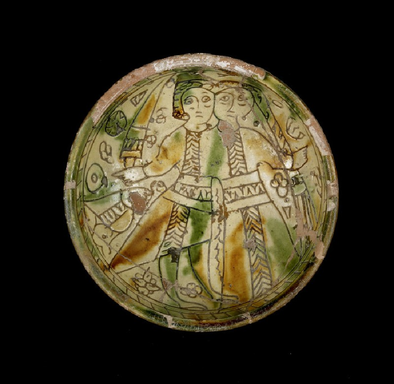 Sgraffito wedding bowl depicting a man with a sword an a woman, probably the married couple (AN1978.732)