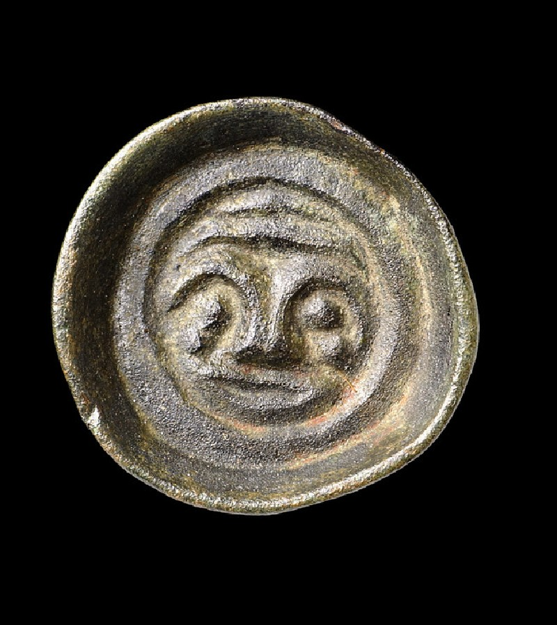 Button brooch with anthropomorphic face-mask and horizontal lines (AN1988.47)