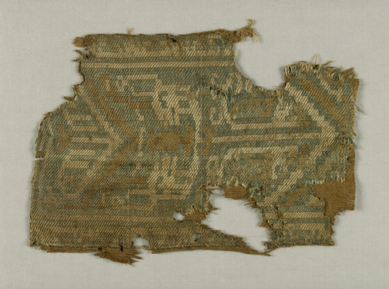 Textile fragment with decorative band