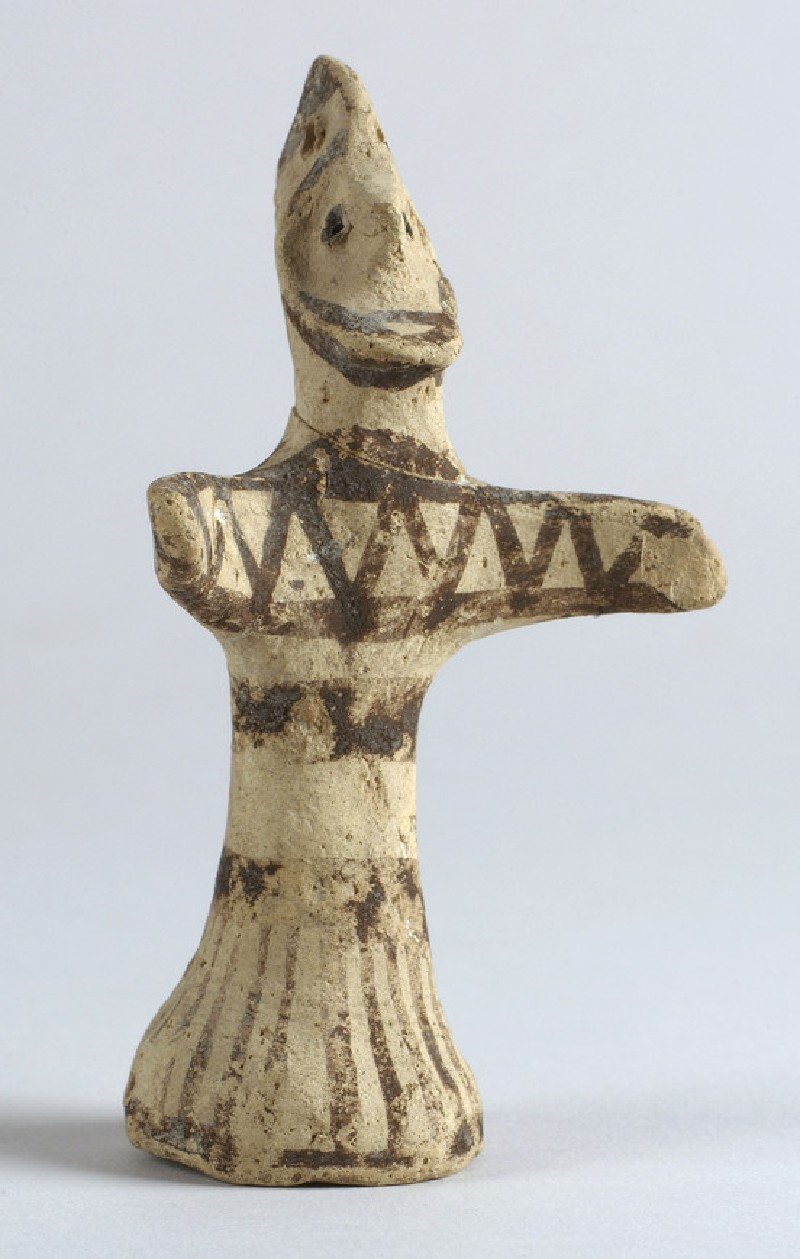 Figurine of bearded and helmeted warrior, bichrome decoration